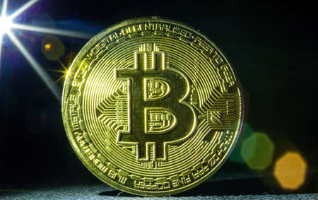 Golden bitcoin cryptocurrency with high value against currency and profitable mining.