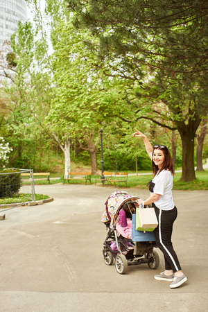 shopping buggy: Woman with pram. Stock Photo