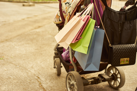 Pram with shopping bags. Stock Photo