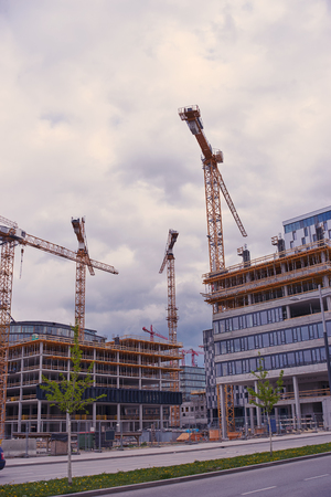 Modern housing development with cranes