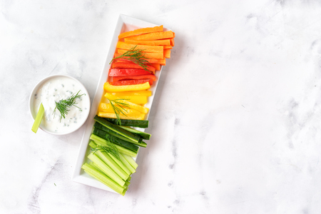 Top view of colorful vegetable sticks on white background. Copy space Stock Photo