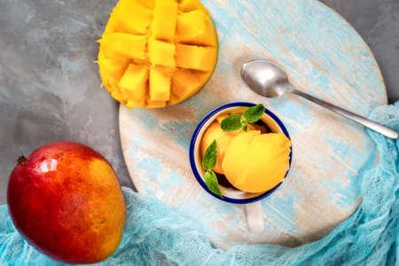 Top view of mango sorbet in cup with mango fruit Banco de Imagens