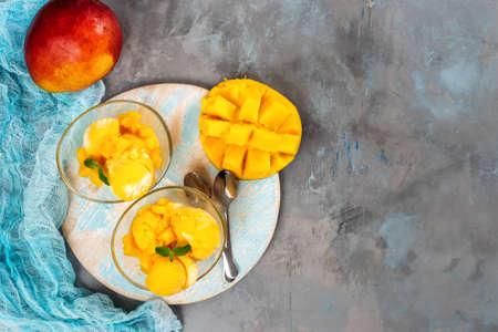 Top view of mango sorbet in cup with mango fruit. Copy space Banco de Imagens
