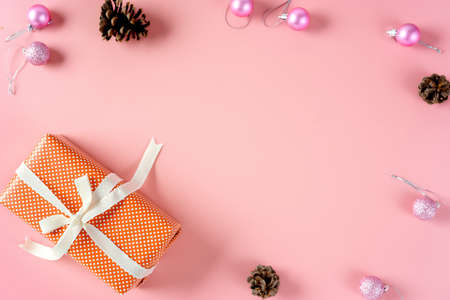 Top view of Christmas gift and decorations on pink background. Toning
