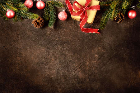 Top view of Christmas gift box with decorations, making upper border. Copy space Stockfoto