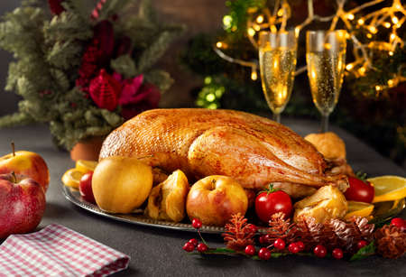 Close up of thanksgiving roasted whole goose on rustic table for holiday dinner Standard-Bild