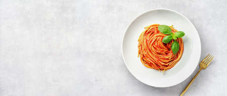 Top view of plate eith pasta in tomato sauce and basil on white background Reklamní fotografie