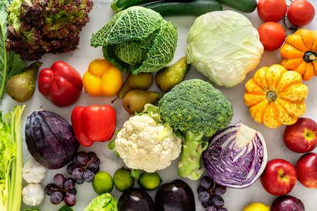 Vegetables on light background. Healthy cooking concept Standard-Bild