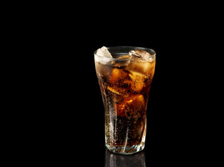 cola glass on black background