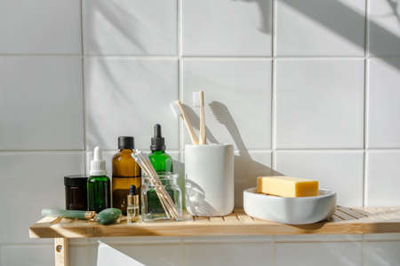 Zero waste bamboo and reusable cosmetic items and toiletries. Organic cosmetis. Wellness and sustainability concept. Shadows on the wall