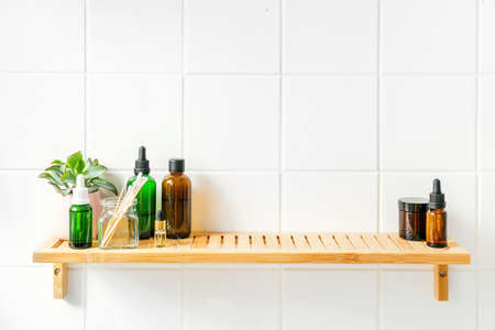 Zero waste bamboo and reusable bottles, organic cosmetics and toiletries. Wellness and sustainability concept. Shadows on the wall