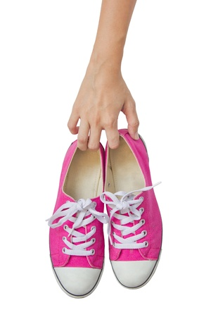 show off: Bright Pink Canvas Shoes Handle On White Background