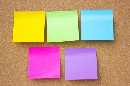 to post: Wooden board with five blank colorful sticky notes