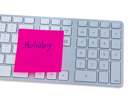 write off: Holiday concept with computer keyboard and note with holiday  Stock Photo