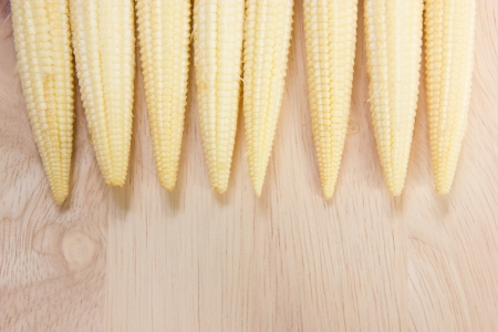 baby corn: Baby corn row on chopping block