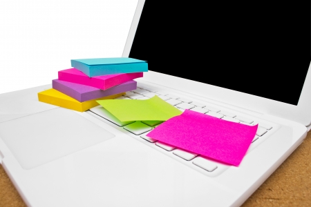 Colorful sticky notes on white  laptop  Stock Photo - 16395570