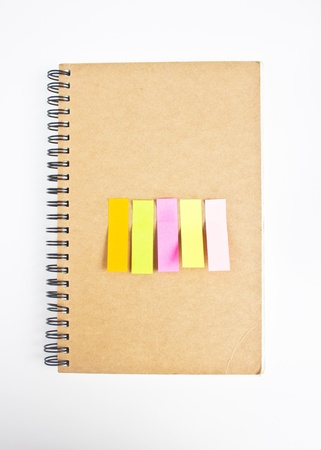 Colorful sticky notes on notebook photo