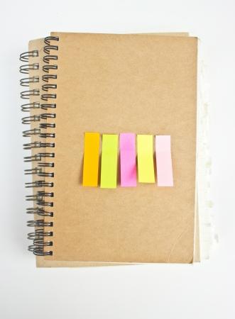 Colorful sticky notes on notebook Stock Photo - 16395806