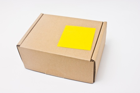 Blank yellow sticky note post on paper box   photo