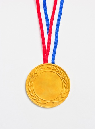 Golden medal isolated on white background    photo