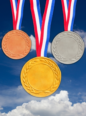 Bronze silver and golden medals with blue sky background   photo
