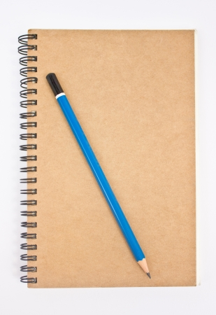 Blue pencil on brown notebook Stock Photo - 16396548