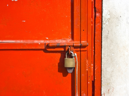 lock block: Red metal door locked by key.