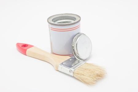 Paintbrush with paint pot isolated on white background  photo