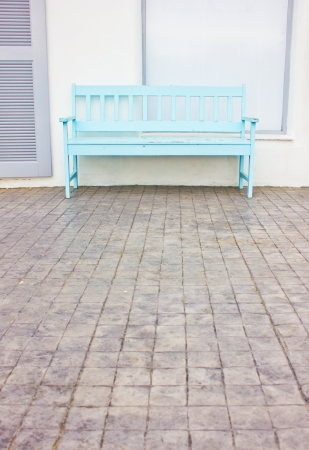 Blue wooden chair at the sidewalk Stock Photo - 17405305
