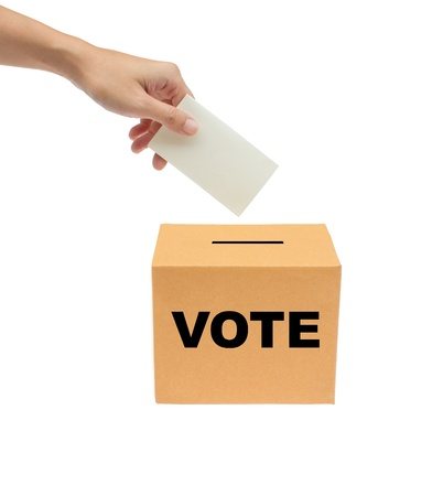 voter: Hand putting a voting ballot into the box isolated on white background