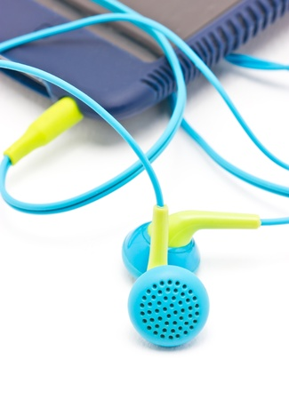 portable mp3 player: Colorful earphones with portable mp3 player isolated on white background