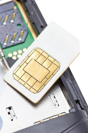 telephony: Close up of cell phone and sim card