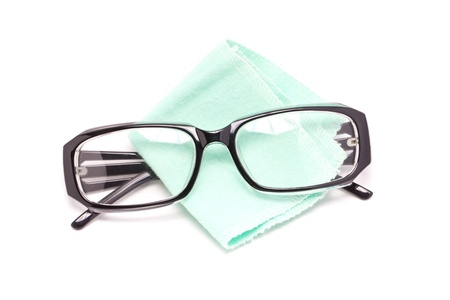 educations: Eye glasses with cleaning cloth isolated on white background  Stock Photo