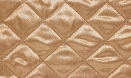 quilted: Beige quilted background.