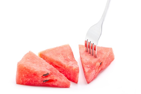 Pieces of watermelon with fork isolated on white background. photo