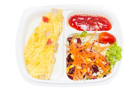 Omelette with fresk salad in white plastic box  photo