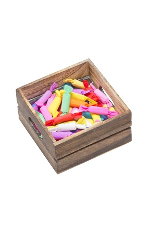 Colorful antique candy in wooden crate. photo