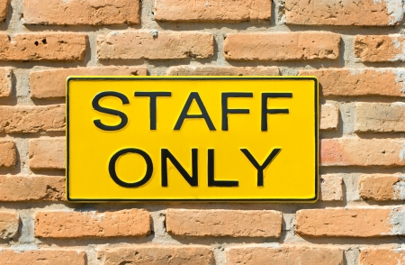 staff only: staff only sign on brick wall. Stock Photo
