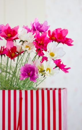 Artificial flower in modern vase. Stock Photo - 20415537