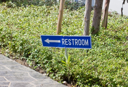 privy: Restroom text sign at the park. Stock Photo