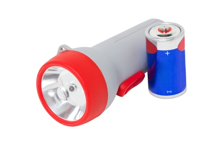 Flashlight with battery isolated on white  photo