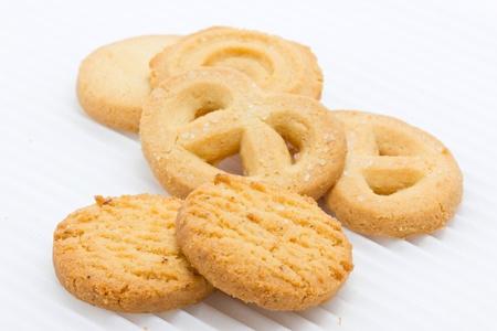 白で隔離されるバター クッキーのグループです。 写真素材