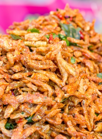 Heap of crispy fried fish in the market  photo