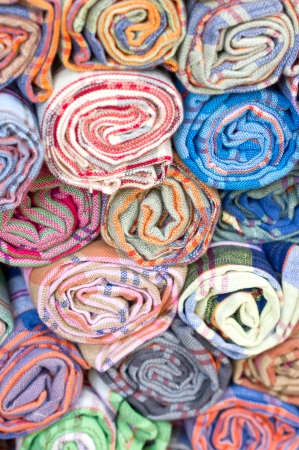 taylor: Rolls of colorful fabric.