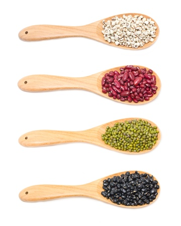 Job s tears, Kidney beans, Mung beans and Black beans with wooden spoon isolated on white