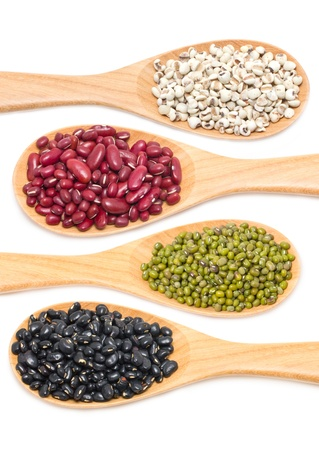Job s tears, Kidney beans, Mung beans and Black beans with wooden spoon isolated on white   photo