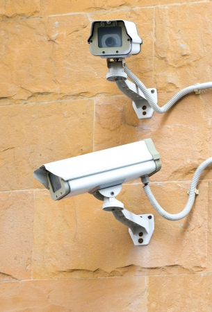 Two CCTV security cameras on the corner of a building  photo
