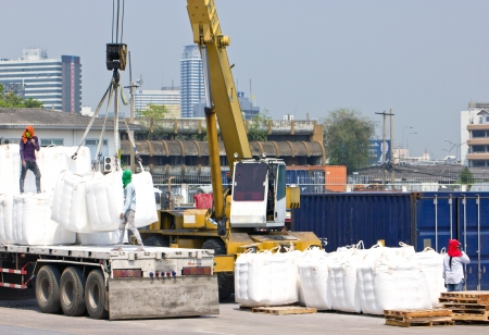 haul: Truck transporting in port for cargo  Stock Photo