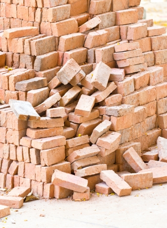 cement pile: Pile of red bricks at construction site