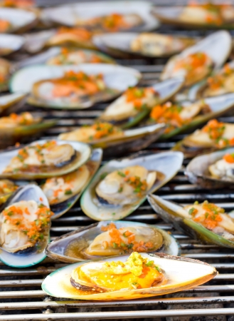 Green Mussel  Perna viridis  on the grill  photo